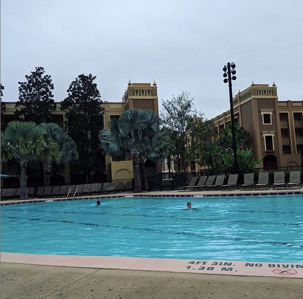 The kids swimming in the hotel pool