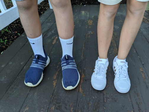 Scorch, wearing navy blue sneakers, and Bean, wearing white sneakers, on the first day of 8th and 6th grade.